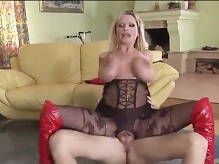 Enormous boobs on fucked blonde in body stocking