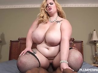 big blonde hair girl hair in stockings enjoys making out with black stud