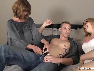 Milf Gets Horny To See  Young Couple On The Bed