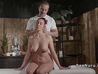 Bent over busty babe banged on massage