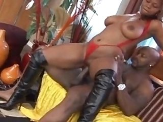 Black floozy in leather boots takes black dick