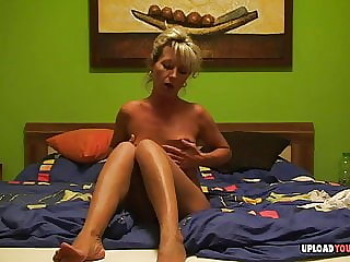 Blonde MILF fingers her tight wet pussy