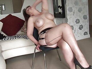 Big tits Mature Milf strips and shows off her shaved pussy