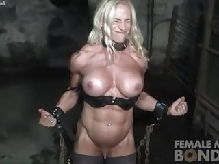 Big Tit Muscled Blonde Bodybuilder In Chains in the Gym