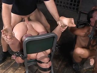 Two sex slaves in bondage used by their masters